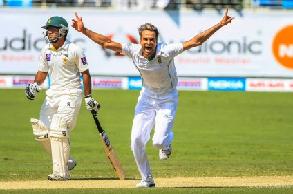 Imran Tahir celebrates after taking wicket of the Pakistan batsman Adnan Akmal, during the first day of the test macth between Pakistan and South Africa at Dubai Cricket stadium at Dubai Sports City, Dubai.